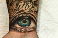 Green Eye Wrist Tattoo