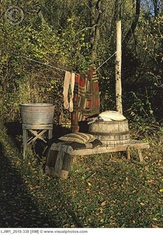 FALL SEASON: Antique wash tubs on bench, worn and weathered, clothes line, old quilts and vintage stockings hang on the line, [LJW1_2518-338]