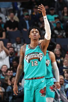 Ja Morant of the Memphis Grizzlies reacts to play against the Cleveland Cavaliers on January 2020 at FedExForum in Memphis, Tennessee. Nba Pictures, Basketball Pictures, Mba Basketball, Basketball Players, Memphis Grizzlies Jersey, Kobe Bryant Pictures, Sports Graphic Design, Nba Wallpapers, Nba Sports