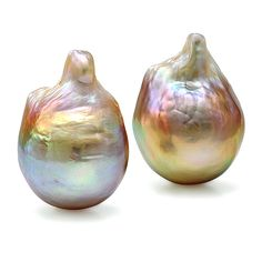 Stunning pair of fancy baroque freshwater pink pearls with yellow, green and purple overtone.