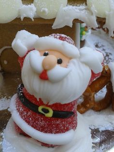 Christmas Gingerbread House - White chocolate roof with pretzel fence.