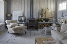 """This is a British sea side cottage but I like the almost surreal feel to it. Though it is an actual place it feels distant and """"artsy"""" for lack of a better word"""