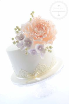 The sugar flowers (peony, hydrangea blossoms and berries) are the stand-out feature on this gorgeous little cake.
