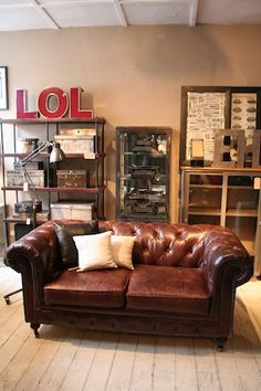New vintage style leather Chesterfield 2 seat sofa.