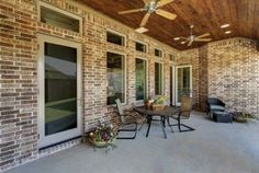 PATIO: Fiberglass single panel swing doors pair with windows to open up the patio.