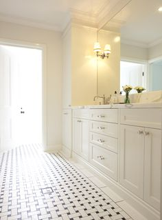 bathrooms - basketweave tiles floor white shaker bathroom cabinets calcutta marble countertops Beautiful bathroom design with basketweave tiles