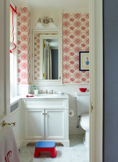 vanity (also showing: subway tile, medicine cabinet, wallpaper, sconce over cabinet)