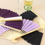 Help your wedding guests beat the heat while still looking chic with these personalized paper fans with metallic foil labels.