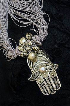 Palm-shaped amulet popular throughout the Middle East and North Africa.The symbol predates Christianity and Islam. In Islam, it is also known as the hand of Fatima, so named to commemorate Muhammad's daughter Fatima Zahra (c. 605 or 615[3] – 633). Levantine Christians call it the hand of Mary, for the Virgin Mary. Jews refer to it as the hand of Miriam in remembrance of the biblical Miriam, sister of Moses and Aaron.