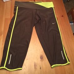 Nike Capri work out pants Nike DRI-FIT work out pants with zipper in back. Brown and yellowish-green. Size M Excellent condition Nike Pants Capris