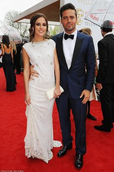 may 2013.   Classy act: Made in Chelsea's Lucy Watson, here with current boyfriend Spencer Matthews, looked beautiful in her full length dress