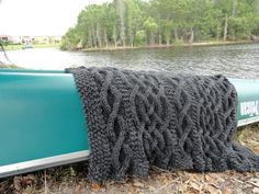 cable knit blanket pattern. In super bulky yarn, this would be a pretty, quick knit