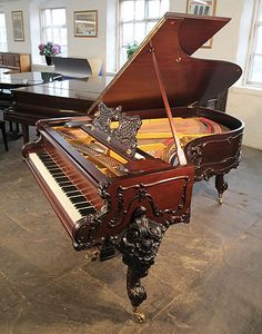 A 1911, Schiedmayer Model 3 Grand Piano For Sale with an Ornately Carved, Louis XV Style Mahogany Case and Cabriole Legs at Besbrode Pianos £20,000. Cabinet features scrolling acanthus, rocailles and coquilles typical of rococo ornament. Piano is restored.