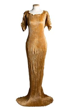 Dress, c. 1910s, Mariano Fortuny Delphos or Greek-style dress, designed by Mariano Fortuny,  . This gown has Venetian glass beads on the neckline drawstring and was worn by Ethel Sanford (1873-1924).