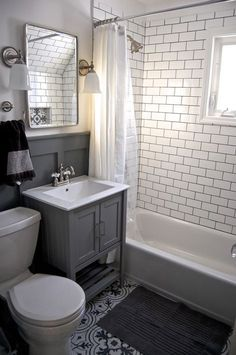 Bathroom - Small grey and white bathroom renovation update Subway tile, grey vanity, recessed cabinet, decorative tile, subway tile Diy Bathroom Remodel, Bathroom Renos, Bathroom Flooring, Bathroom Interior, Bathroom Small, Bathroom Grey, Glass Bathroom, Gray And White Bathroom Ideas, Light Bathroom