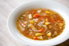 Vegetable Soup with Sweet Basil ~ Soup au Pistou— a wonderful vegetable soup recipe with fresh tomatoes, leeks, potato, onion, celery, zucchini, green beans, carrots, and basil. ~ SimplyRecipes.com