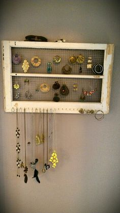 Jewelry holder from old window. Hooks on the bottom for necklaces