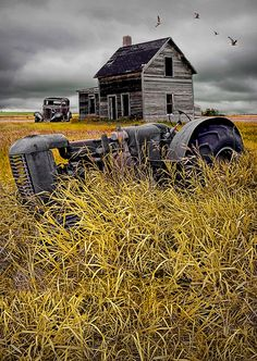 "This is Amazing! It's a photo composite and it looks like an Andrew Wyeth Painting!! ""Abandoned Small Prairie Farm with rusted Tractor and Auto"" by Randy Nyhof"