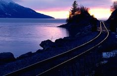 Turnagain Arm at Sunset  Alaska. Anchorage. The Alaska Railroad lines along the Cook inlet and the Turnagain Arm. Sunset.