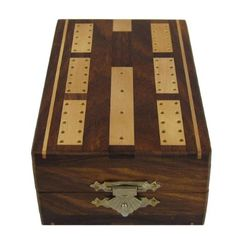 The cribbage board and the pegs are handcrafted in natural sesum wood. This is a unique gift item to own as well as to give.