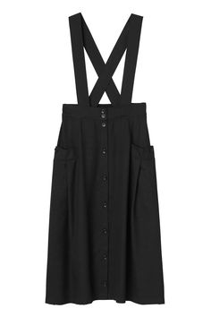 Skirt + suspenders = a totally serious power combo! A strongly stylish look with buttons running up the front, welt pockets on the sides, crisscross suspenders and an elasticized waist all in that midnight shade. Time to work on your power stance gals! colour: black magic  In a size small the waist width is 69 cm and the length is 77 cm. The model is 170 cm and is wearing a size small.