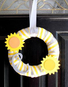 """You are my sunshine party wreath. Good alternative to the diaper wreath. Looks really simple. I have yellow ribbon and can get the suns and letter from Michaels or Hobby Lobby. Or we can hang this on the door with message """"Welcome to Pearl's baby Shower"""" in the middle."""