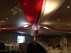 Overhead circus tent swag / Red and white / plastic tablecloth / Icicle light chandelier / vintage circus / carnival theme / formal