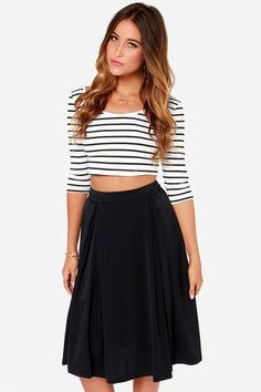 I love a black just-below-the-knee skirt. Looks great year round. #featuredpin