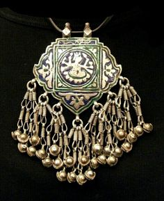 Silver pendant from Himachal withgreen and blue enamel work