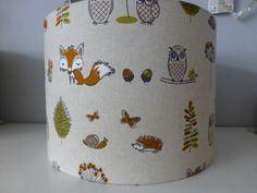 A drum lampshade in this cute Woodland Animals cotton fabric, made for you to fit a lamp base or ceiling pendant.  Carefully handmade using professional materials including fire retardant PVC, that meets UK standards.  Dimensions: Diameter: 30cm/12 Height: 20cm  Diameter 20cm Height 18cm  Other matching items available in the Woodland design, plus lampshades also available in Nursery and Comic book fabrics as photos 2 - 5 as photos or email me for a custom order.