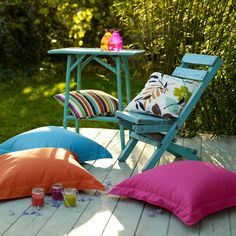 Give a small decking area some special treatment. Block-coloured brights in various complementary hues are sure to make an impact. If you have wooden furniture you're thinking of getting rid of, a coat of paint will give it a new look and repurpose it for the garden. Do make sure to choose a weather-resistant finish, though.