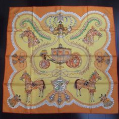 This is an authentic HERMES Silk Paperoles Scarf 90.   The exceptional quality and charming beauty of this Hermes scarf make it an iconic fashion accessory.