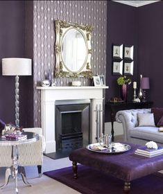 I love how they layered different shades of purple for this. I'm not one to decorate my entire living room in purple, but this is great.