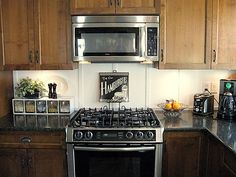 Board and batten backsplash | Funky Junk InteriorsFunky Junk Interiors.  Dark cabinets that I really love!