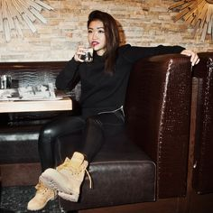 """""""Some people go on party hiatus once the cold weather hits, but sometimes a casual night on the town with friends is much needed. Rock a crew neck sweatshirt over leather (real or faux) leggings and classic Timbs."""" - Anna"""