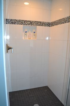 tile shower. slate floor. accent tiles. white tiles