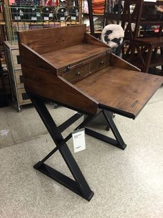 World Market Secretary Desk 229 pos 502391 Very narrow, surface pushes in & it totally folds up. Looks a little chunky though.
