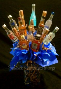 bouquet made of mini liquor bottles (Liquor Bottle Cake) Liquor Bottle Cake, Mini Alcohol Bottles, Liquor Cake, Mini Bottles, Alcohol Gift Baskets, Liquor Gift Baskets, Alcohol Gifts, Adult Birthday Party, Birthday Gifts