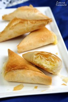 Light and flaky Greek pies filled with feta cheese, Tiropita make for a wonderful appetizer or snack that everyone is sure to enjoy!   www.CuriousCuisiniere.com