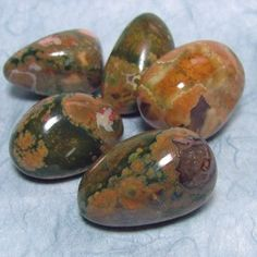 Rainforest Jasper (Rhyolite): It brings awareness and joy for the natural state of things, such as your own body, emotional balance, interaction with other living people and organisms.  Rainforest Jasper can be used to invigorate or renew your emotional state. It brings hope and positive energy to alleviate depression or lethargy.