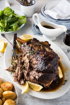 Slow Roasted GREEK Leg of Lamb - Tender fall apart lamb made the Greek way! Super easy. #food recipe