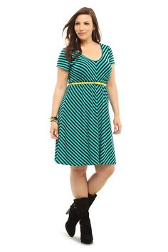 Black mitered stripes create playful patterns across a short sleeve knit dress in color-of-the-season emerald green. We've included a skinny yellow belt for an eye-catching pop of contrast.