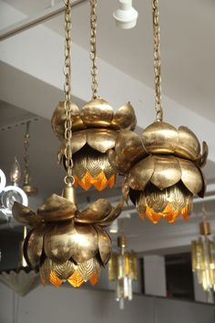 View this item and discover similar for sale at - A trio of lotus blossom lights hung at graduating lengths. They look great hung in a grouping, but can also be hung as separate pendants.