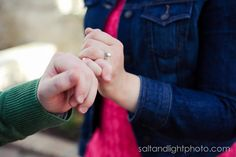 A Walk in the Park | Salt & Light Photography #spring #engagements #green #flowers #dress #cute #ring #pinky #promise