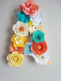 Handmade paper flower placed in Paper mache lettering. Perfect for weddings and events. Can be hung to create wedding initials or used on a