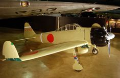 A Mitsubishi A6M Zero, painted to represent a section leader's aircraft from the Japanese aircraft carrier Zuihō during the Battle of the Bismarck Sea