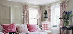 Luv this cozy country chic living room with floral accents.