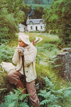 Country Idyll - Old British Vogue 1973 - Barry Lategan  I love everything about this photo, from the yummy warm outfit to the cottage in the wooded glen.