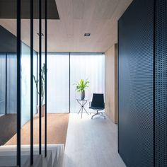 Minimalist interior with light wood and black accents