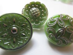 Vintage Buttons - lot of 3 assorted green pressed pattern Czech Glass, silver hand painted (lot 4286). 7.25, via Etsy.